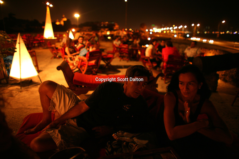 Friends enjoy a drink at the Café del Mar, located atop the wall that surrounds the old city in Cartagena, on Friday, April 18, 2008. (Photo/Scott Dalton)