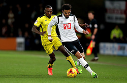 Cyrus Christie of Derby County is put under pressure from Lloyd Dyer of Burton Albion - Mandatory by-line: Robbie Stephenson/JMP - 21/02/2017 - FOOTBALL - iPro Stadium - Derby, England - Derby County v Burton Albion - Sky Bet Championship