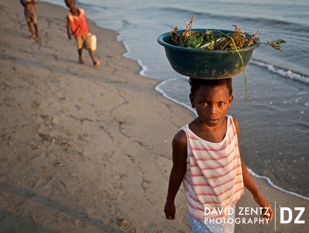 Children walk along the beach where others had gathered for the Bord de Mer de Limonade voodoo festival on the north coast of Haiti on July 25, 2008.