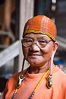 This Kelabit woman has retained her tradtional long ears, she also sports the tattoos on her legs that were a sign of beauty in her younger days.