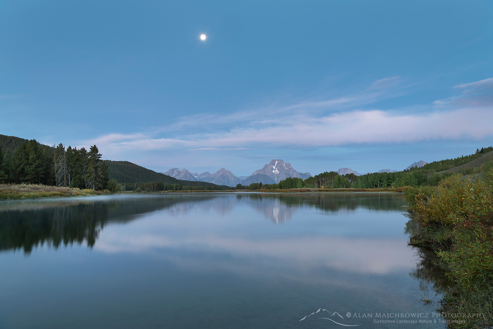 Full Moon over Mount Moran reflected in still waters of the Snake River at Oxbow Bend, Grand Teton National Park Wyoming