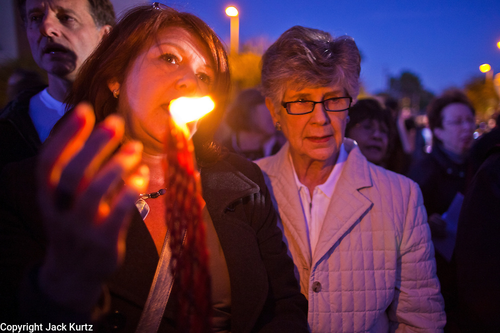 "15 JANUARY 2011 - TUCSON, AZ: People attend a Jewish religious service at a memorial on the lawn in front of the University Medical Center in Tucson, AZ, Saturday, January 15. The memorial has been growing since the mass shooting last week. Six people were killed and 14 injured in the shooting spree at a ""Congress on Your Corner"" event hosted by Congresswoman Gabrielle Giffords at a Safeway grocery store in north Tucson on January 8. Congresswoman Giffords, the intended target of the attack, was shot in the head and seriously injured in the attack. She is hospitalized at UMC. The alleged gunman, Jared Lee Loughner, was wrestled to the ground by bystanders when he stopped shooting to reload the Glock 19 semi-automatic pistol. Loughner is currently in federal custody at a medium security prison near Phoenix.  Photo by Jack Kurtz"