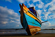 Colorful fishing boat on the beach on Ilha do Mel, Brazil, South America