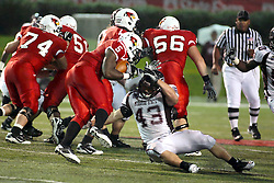 25 September 2010:  Adam Beauchamp gets a foothold on runner Ashton Leggett.  The Missouri State Bears lost to the Illinois State Redbirds 44-41 in double overtime, meeting at Hancock Stadium on the campus of Illinois State University in Normal Illinois.