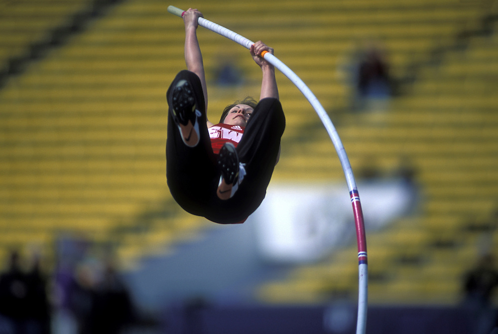USA, Washington, Seattle, Women's Pole Vaulter competes at University of Washington Track Meet at Husky Stadium
