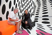 "Daniel Birnbaum (suit) being interviewed by profil's Horst Christoph at the cafeteria by.Tobias Rehberger..Giardini, Palazzo delle Esposizioni. International exhibition ""Fare Mondi // Making Worlds // Bantin Duniyan // ???? // Weltenmachen // Construire des Mondes // Fazer Mundos..."" curated by Daniel Birnbaum."