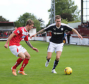 Kevin Holt takes on Kevin Buchan - Brechin City v Dundee, pre-season friendly at Glebe Park<br />