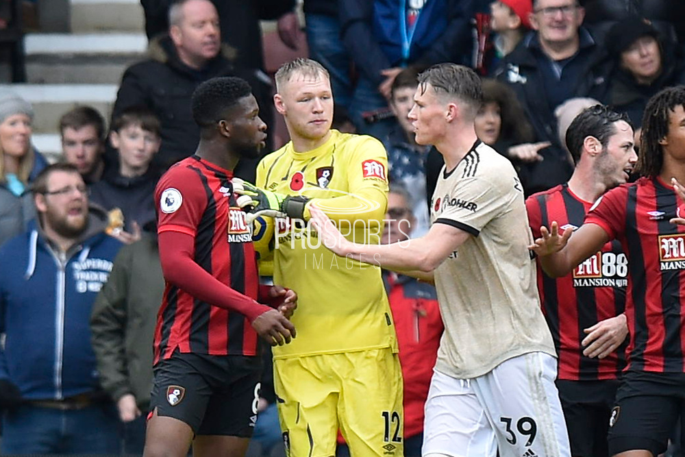 Jefferson Lerma (8) of AFC Bournemouth is held back from Scott McTominay (39) of Manchester United by Aaron Ramsdale (12) of AFC Bournemouth as tensions flare during the Premier League match between Bournemouth and Manchester United at the Vitality Stadium, Bournemouth, England on 2 November 2019.