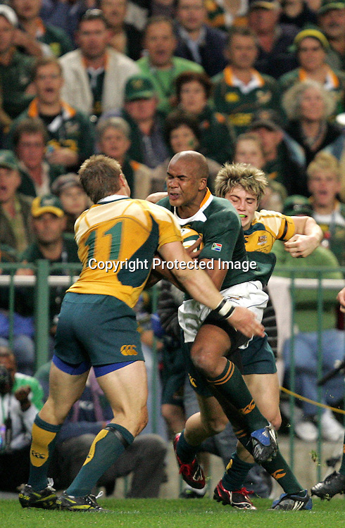 JP Pietersen runs into the tackle of Drew Mitchell during the first 2009 tri-nations test match between South Africa and Australia held on the 8 August 2009 at Newlands Stadium in Cape Town, South Africa..Photo by RG/www.sportzpics.net.+27 (0) 21 785 6814