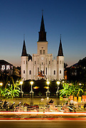 Horse and carriages line up at dusk in front of Jackson Square in New Orleans, Louisiana.