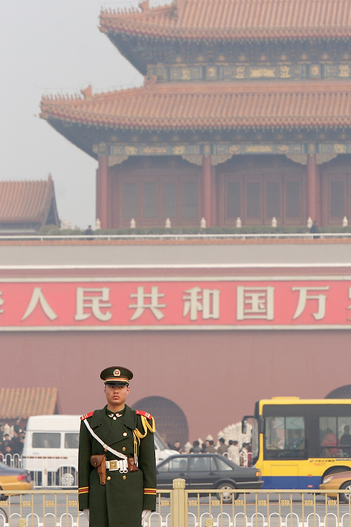 On guard at the northern most part of Tiananmen Square, this soldier and one another stand beside the Chinese national flag in Beijing, China.