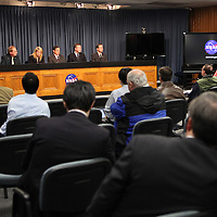 Members of NASA and SpaceX discuss the Falcon 9 rocket test launch delay at a media event after cracks were discovered on a nozzle of the rocket on December 6, 2010 at Cape Canaveral, Florida. (AP Photo/Alex Menendez)
