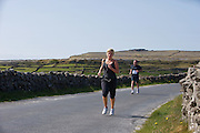 A weekend of glorious weather welcomed approximately 150 people from all over the country and abroad to Inis Mor to participate in the annual Aer Arann half marathon.  Over the past ten years people have walked and ran the roads of Inis Mor to raise in excess of 1.2 million to purchase vital life saving equipment for sick children in both Crumlin and Temple Street hospitals. Nadine Miller from Knocknacarra in Galway celebrated her birthday by doing the run . Photo:Andrew Downes.