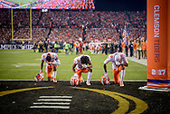 Clemson players kneel during the National Anthem, prior to the kickoff of the college football national championship game in Tampa, Florida.