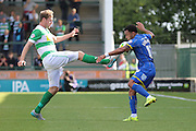 Andy Barcham of AFC Wimbledon takes a hit during the Sky Bet League 2 match between Yeovil Town and AFC Wimbledon at Huish Park, Yeovil, England on 12 September 2015. Photo by Stuart Butcher.