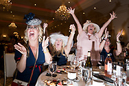 """Women cheer at the """"Tea for Trump"""" birthday party for the president at the Trump Hotel in Washington, D.C. on June 24, 2018. (photo by Erin Schaff)"""