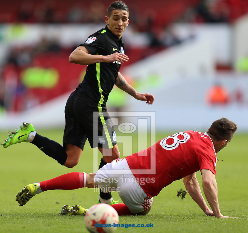 Anthony Knockaert (left) of Brighton and Hove Albion passes the ball past Chris Cohen of Nottingham Forest during the Sky Bet Championship match at the City Ground, Nottingham<br /> Picture by James Wilson/Focus Images Ltd 07709 548263<br /> 04/03/2017