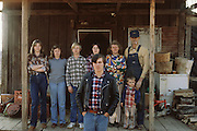 Johnny Walton, with leather jacket, in front of his family on the porch of their rural farmhouse. Johnny was just released from jail (theft of a rifle from a neighbor) when this photo was made. MODEL RELEASED..