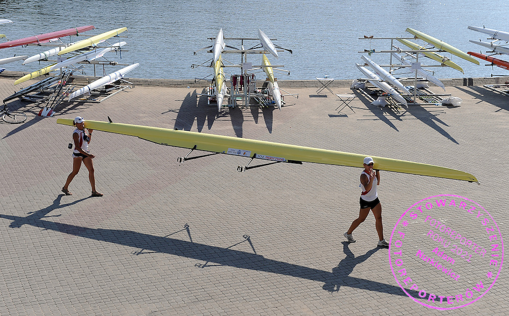 (L) JULIA MICHALSKA & (R) MAGDALENA FULARCZYK (BOTH POLAND) AFTER TRAINING EVENING SESSION DURING DAY THREE OF REGATTA WORLD ROWING CHAMPIONSHIPS ON MALTA LAKE IN POZNAN, POLAND...POZNAN , POLAND , AUGUST 25, 2009..( PHOTO BY ADAM NURKIEWICZ / MEDIASPORT )..PICTURE ALSO AVAIBLE IN RAW OR TIFF FORMAT ON SPECIAL REQUEST.