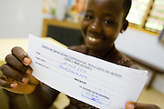 Koffi Aya Rose, 19, holds a form indicating that she tested negative for HIV at the NDA health center in Dimbokro, Cote d'Ivoire on Friday June 19, 2009.