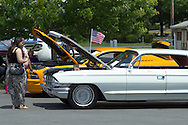 Middletown, New York - People look at cars at the YMCA Community Fun Day Car Show at the Middletown YMCA on June 2, 2013. The YMCA of Middletown hosted the show in partnership with the Tri-States Car Club and Elks Lodge 1097. ©Tom Bushey / The Image Works