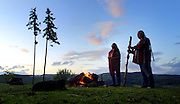 Steve and Cindy Vincent of Falls, City, Oregon, await the darkness while standing about their sacred fire circle. They are Winnimem Wintu Indians and have a sacred fire circle, sweat lodge and teepee  overlooking the Willamette forest land just below their property.