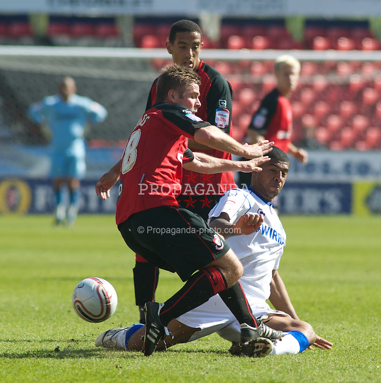 BOURNEMOUTH, ENGLAND - Saturday, April 9, 2011: Tranmere Rovers'  Jos Labadie tackles Bournemouth's Warren Cummings late during the Football League One match at the Dean Court Stadium. (Photo by Gareth Davies/Propaganda)