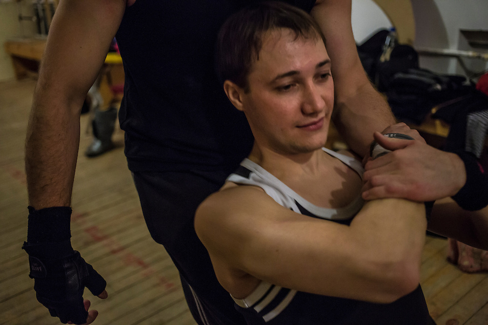 "Nikolai Ross, 25, rehearses an acrobatic act with Yevgeny Tremasov (R), 28, back stage at the local arts center on Tuesday, November 12, 2013 in Asbest, Russia. Ross and Tremasov work at the Uralasbest asbestos factory in town, among the largest producers of the chrysolite form of asbestos in the world. Ross carries the title ""Best Guy of the Factory"" for 2013 and serves on the city's youth council. Tremasov was ""Best Guy of the Factory"" in 2012."