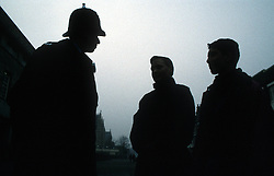 Silhouette of community police officer and two boys,