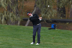 Feb 11, 2012; Pebble Beach CA, USA; D. J. Trahan hits his second shot on the third hole during the third round of the AT&T Pebble Beach Pro-Am at Pebble Beach Golf Links. Mandatory Credit: Jason O. Watson-US PRESSWIRE