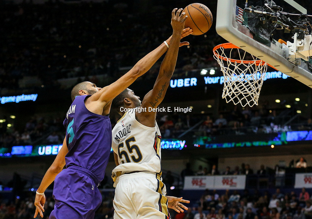 Mar 13, 2018; New Orleans, LA, USA; Charlotte Hornets guard Nicolas Batum (5) blocks a shot by New Orleans Pelicans forward E'Twaun Moore (55) during the second half of a game at the Smoothie King Center. The Pelicans defeated the Hornets 119-115.  Mandatory Credit: Derick E. Hingle-USA TODAY Sports