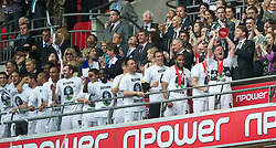 LONDON, ENGLAND - Saturday, May 30, 2011: Swansea City's Alan Tate lifts the trophy after his side beat Reading 4-2 after the Football League Championship Play-Off Final match at Wembley Stadium. (Photo by David Rawcliffe/Propaganda)