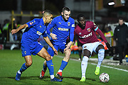 Wimbledon defender Dylan Connolly(16), Wimbledon defender Tennai Watson (2) and West Ham United defender Arthur Masuaku (26) battle for the ball during the The FA Cup fourth round match between AFC Wimbledon and West Ham United at the Cherry Red Records Stadium, Kingston, England on 26 January 2019.