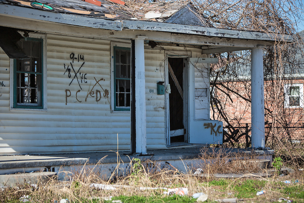 """New Orleans, LA, January 20, Home in New Orleans lower 9th Ward with a  Katrina tattoo, a """"X"""" code, spray-painted by search-and-rescue teams on homes after hurricane Katrina.Nine years after hurricane Katrina parts of the city have still not recovered."""
