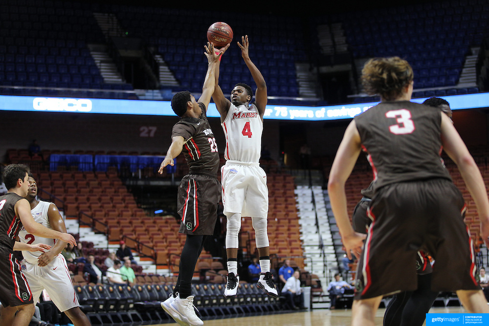 Isaiah Lamb, Marist, shoots over Jason Massey, Brown, during the Marist vs Brown Men's College Basketball game in the Hall of Fame Shootout Tournament at Mohegan Sun Arena, Uncasville, Connecticut, USA. 22nd December 2015. Photo Tim Clayton
