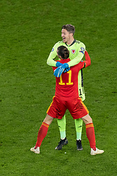 CARDIFF, WALES - Tuesday, November 19, 2019: Wales' captain Gareth Bale and goalkeeper Wayne Hennessey celebrate after a 2-0 victory ensures qualification to Euro 2020 after the final UEFA Euro 2020 Qualifying Group E match between Wales and Hungary at the Cardiff City Stadium. (Pic by Paul Greenwood/Propaganda)