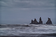 Reynisdrangar are basalt sea stacks situated under the mountain Reynisfjall near the village V&iacute;k &iacute; M&yacute;rdal, southern Iceland.<br /> Legend says that the stacks originated when two trolls dragged a three-masted ship to land unsuccessfully and when daylight broke they became needles of rock