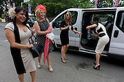 A minibus of women arrive at the racecourse during the annual Royal Ascot horseracing festival in Berkshire, England. Royal Ascot is one of Europe's most famous race meetings, and dates back to 1711. Queen Elizabeth and various members of the British Royal Family attend. Held every June, it's one of the main dates on the English sporting calendar and summer social season. Over 300,000 people make the annual visit to Berkshire during Royal Ascot week, making this Europe's best-attended race meeting with over £3m prize money to be won.