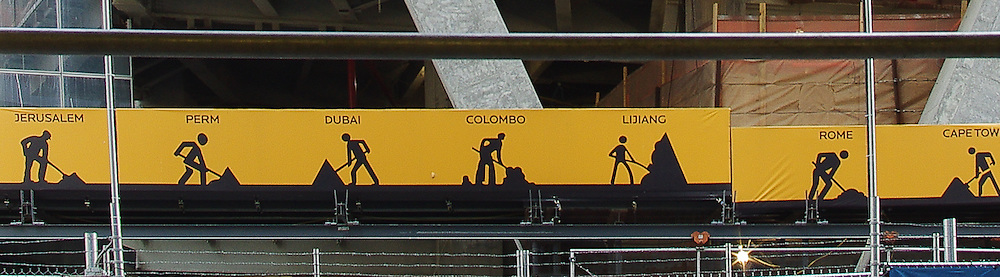 A banner stretched across the length of floors under construction depicts the multiple nationalities represented by those working on re-building on and around ground zero.