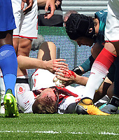 Football - 2017 Community Shield - Chelsea vs. Arsenal<br /> <br /> Per Mertesacker of Arsenal lies on the ground with Blood coming from his head after clashing with Gary Cahill of chelsea and as a result had to be substituted   at Wembley.<br /> <br /> COLORSPORT/ANDREW COWIE