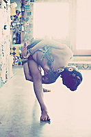 Woman in a twisted bound yoga pose.