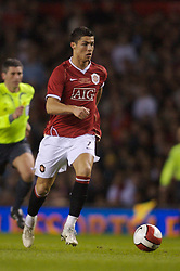 Manchester, England - Tuesday, March 13, 2007: Manchester United's Christiano Ronaldo in action against Europe XI uring the UEFA Celebration Match at Old Trafford. (Pic by David Rawcliffe/Propaganda)