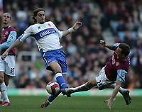 Photo: Lee Earle.<br /> West Ham United v Middlesbrough. The Barclays Premiership. 31/03/2007.West Ham's Mark Noble(R) slides in on Jonathan Woodgate.