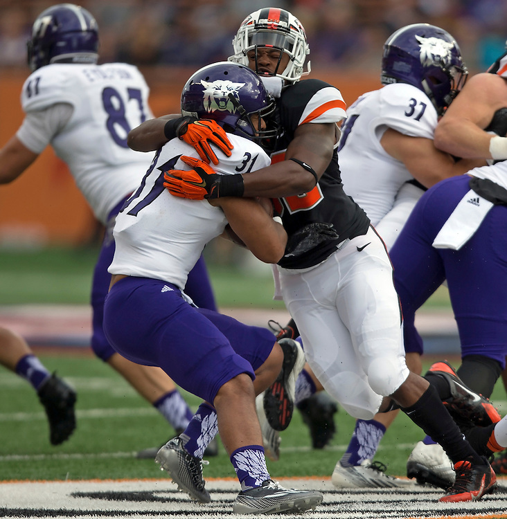 Weber State runningback Haini Moimoi (31) is tackled by Oregon State'sJonathan Willis during the Beavers' 26-7 victory in the 2015 season opener in Reser Stadium, in Corvallis, on Friday, Sept. 4, 2015.