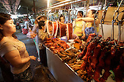 Cholon (Chinatown). Binh Tay Market. Woman selling roasted meat.