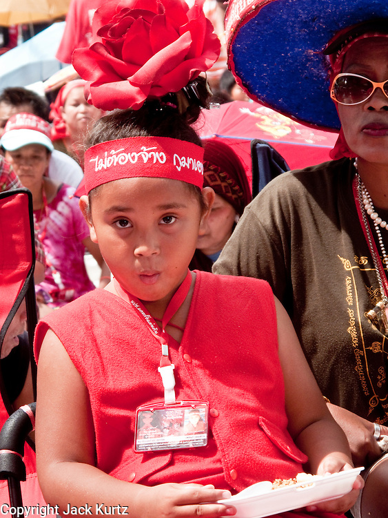 11 MAY 2010 -- BANGKOK, THAILAND: A Red Shirt child at the protest in Ratchaprasong Intersection. The Red Shirts are continuing their protests in Bangkok and demanding the dissolution of the Thai parliament and resignation of Thai Prime Minister Abhisit Vejjajiva.  PHOTO BY JACK KURTZ