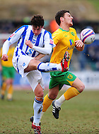 Brighton - Saturday 13th February, 2010: Tommy Elphick of Brighton & Hove Albion and Chris Martin of Norwich City during the Coca Cola League One match at The Withdean, Brighton...(Pic by Alex Broadway/Focus Images)