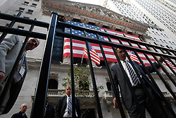 Traders gesture outside the New York Stock Exchange in Wall Street in New York, New York, USA, 20 October 2008. As Wall Street descend into a financial turmoil not seen since the stock market crash of 1929 and financial businesses were pommeled into rampant sell-offs in stocks and face regulatory changes to their business practices, professionals and non-professionals working in the district's banks, stock-trading houses and insurance companies are showing stress and a gloom not unlike the times of the Great Depression.