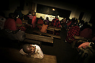 Tanzania, traditional Maasai life. At night on Christmas eve, children sleep in one of the classrooms in the local school, temporarily converted into a catholic church, while waiting for the midnight mass to begin.