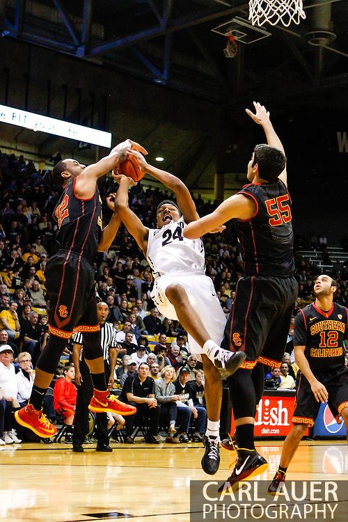 January 18th, 2014:  Colorado Buffaloes freshman guard/forward George King (24) is fouled on a shot attempt in the first half of the NCAA Basketball game between the USC Trojans and the University of Colorado Buffaloes at the Coors Events Center in Boulder, Colorado